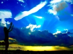 Woman Praising Against a Blue Sky