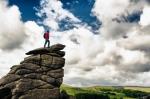 iStock_Hiker on Top of Rocks